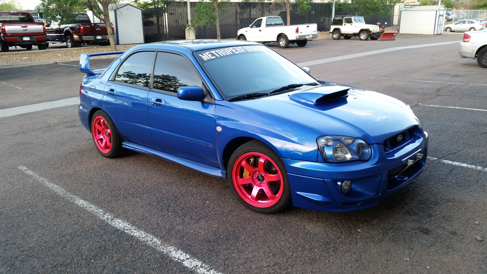 Hot pink powder coated rims on customer car